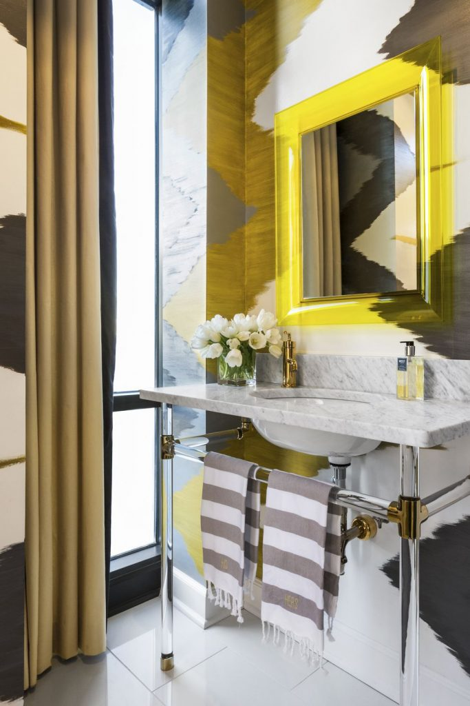 contemporary bathroom with yellow and gray